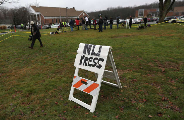 NEWTOWN, CT - DECEMBER 18:  Media gather on the grass to photograph outside the funeral of James Mattioli, 6, at the St. Rose of Lima Catholic church on December 18, 2012 in Newtown, Connecticut. Funeral services were held at the church for both James Mattioli and Jessica Rekos, 6, Tuesday, four days after 20 children and six adults were killed at Sandy Hook Elementary School. Photo: John Moore, Getty Images / 2012 Getty Images