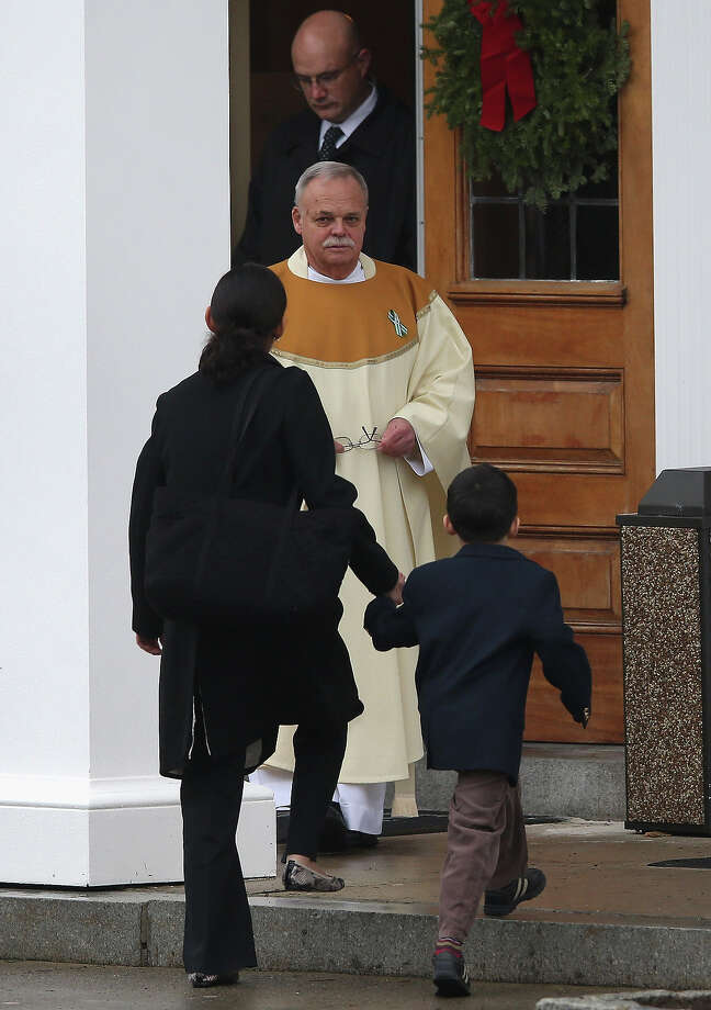 NEWTOWN, CT - DECEMBER 18:  Catholic Monsignor Robert Weiss greets people arriving for the funeral of James Mattioli, 6, at the St. Rose of Lima Catholic church on December 18, 2012 in Newtown, Connecticut. Funeral services were held at the church for both James Mattioli and Jessica Rekos, 6, Tuesday, four days after 20 children and six adults were killed at Sandy Hook Elementary School. Photo: John Moore, Getty Images / 2012 Getty Images