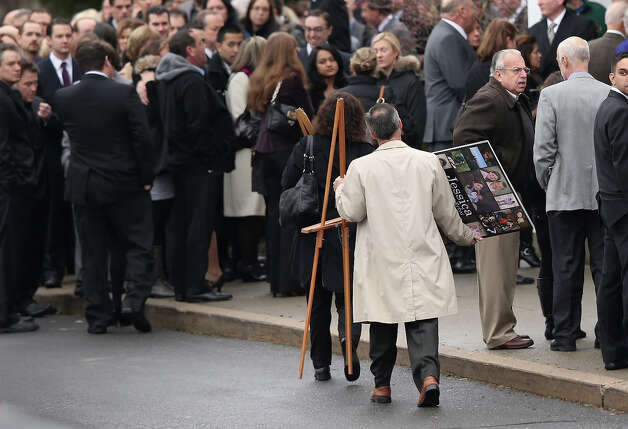 NEWTOWN, CT - DECEMBER 18:  People arrive for the funeral for shooting victim Jessica Rekos, 6, at the St. Rose of Lima Catholic church on December 18, 2012 in Newtown, Connecticut. Funeral services were held at the church for both Jessica Rekos and James Mattioli, 6, Tuesday, four days after 20 children and six adults were killed at Sandy Hook Elementary School. Photo: John Moore, Getty Images / 2012 Getty Images