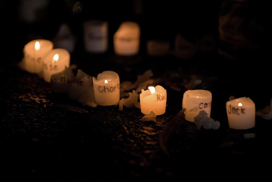 Candles with the names of victims of the Sandy Hook Elementary School shooting written on them are seen at a makeshift memorial near the entrance to the grounds of Sandy Hook Elementary School on December 18, 2012 in Newtown, Connecticut. Students in Newtown, excluding Sandy Hook Elementary School, returned to school for the first time since last Friday's shooting at Sandy Hook which took the live of 20 students and 6 adults.  AFP PHOTO/Brendan SMIALOWSKI Photo: BRENDAN SMIALOWSKI, AFP/Getty Images / 2012 AFP