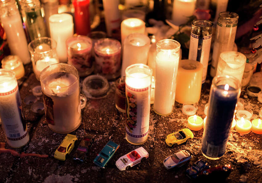 Toy cars are seen with candles at a makeshift memorial on December 18, 2012 in Newtown, Connecticut.
