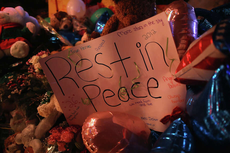 NEWTOWN, CT - DECEMBER 18:  A sign adorns a memorial for shooting victims on December 18, 2012 in Newtown, Connecticut. Funeral services were held in Newtown Tuesday for Jessica Rekos and James Mattioli, both age six, four days after 20 children and six adults were killed at Sandy Hook Elementary School. Photo: John Moore, Getty Images / 2012 Getty Images