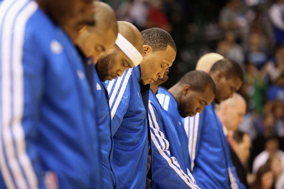 DALLAS, TX - DECEMBER 18:  Center, Shawn Marion #0 and the Dallas Mavericks take a moment of silence for the victims of the shooting that took place at Sandy Hook elementary school in Newtown, Connecticut prior to the game against the Philadelphia 76ers at American Airlines Center on December 18, 2012 in Dallas, Texas.  NOTE TO USER: User expressly acknowledges and agrees that, by downloading and or using this photograph, User is consenting to the terms and conditions of the Getty Images License Agreement. Photo: Ronald Martinez, Getty Images / 2012 Getty Images