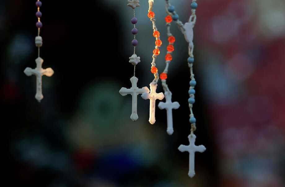 Rosaries are lit by the morning light on a makeshift memorial near the town Christmas tree in the Sandy Hook village of Newtown, Conn., Wednesday, Dec. 19, 2012. The memorial, which was put up in the aftermath of the elementary school shooting that shocked the small town, is increasing in size as the days go on. More funerals are scheduled for Wednesday, as the town continues to mourn its victims. The gunman, Adam Lanza, walked into Sandy Hook Elementary School in Newtown, Conn., Dec. 14, and opened fire, killing 26 people, including 20 children, before killing himself. Photo: AP