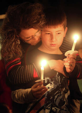Angie Whitworth hugs her son Eli, 10, as prayers are said for the victims of the Newtown, Conn. school shooting on Tuesday, Dec. 18, 2012 in Shelby, N.C. Photo: AP