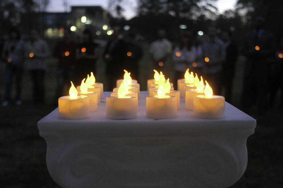 Kingwood community members gather for a candlelight vigil at Lone Star Community College-Kingwood in Kingwood, Texas, Tuesday, Dec. 18, 2012 to show support and pray for the town of Newtown, Conn., and the lives lost in the shooting last Friday. Photo: AP