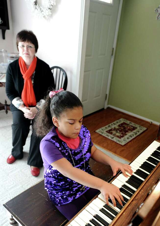 Hailey Hayes, right, is an 11 year old visually impaired piano student of Debbie Goolsby, left.  Hailey has been playing since she was 3 years old. Hayes practices twice a week in Beaumont as seen here at Goolsby's on Wednesday, December 12, 2012. Photo taken: Randy Edwards/The Enterprise