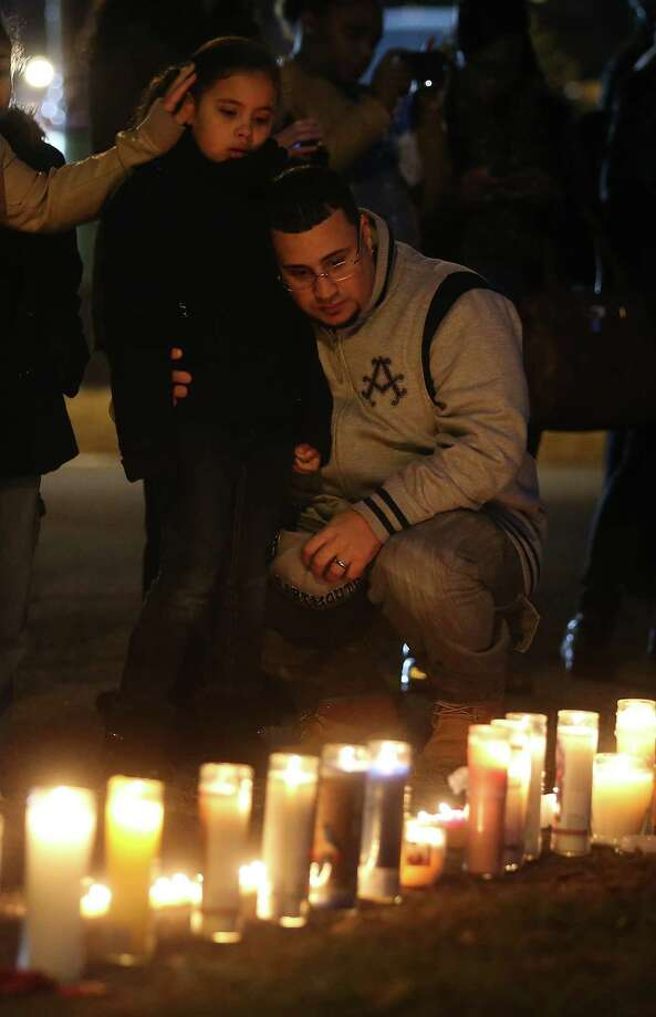 As prayer vigils continue in Newtown, Conn., readers keep grappling with the reasons for the tragedy.  Photo: Mario Tama, Getty Images / 2012 Getty Images