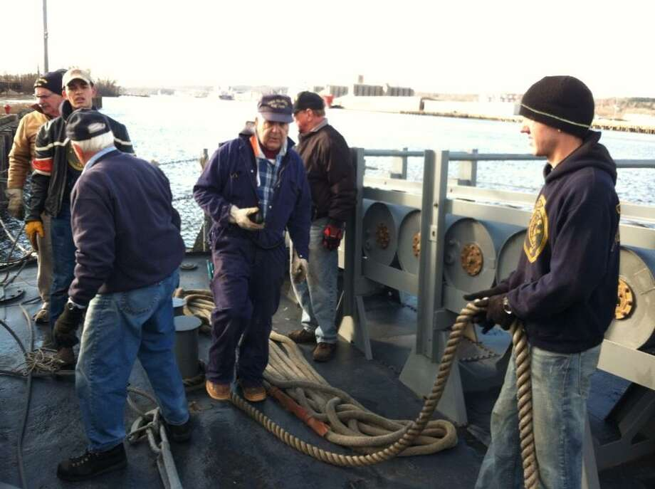 The volunteer crew of the USS Slater ties up the ship to the dock at its winter berth in Rensselaer on Wednesday, Dec. 19, 2012. (Skip Dickstein/Times Union)
