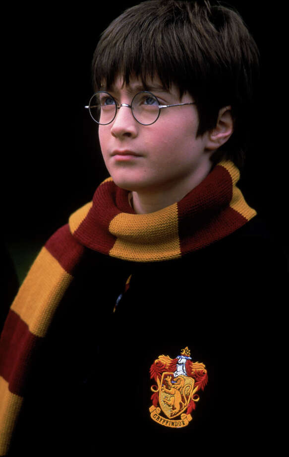 "Daniel Radcliffe, who plays the part of Harry Potter, is shown in this undated handout photo from a scene in Warner Bros. Pictures ""Harry Potter and the Sorcerers Stone."" Makers of the Harry Potter film called in a voice double after Radcliffe's voice broke during filming, a British newspaper reported Thursday, Nov. 1, 2001. The Sun said London schoolboy Joe Sowerbutts was hired to dub two scenes for 12-year-old star. Photo: AP / WARNER BROS"