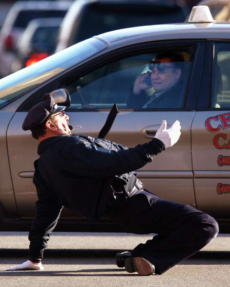 In this Dec. 13, 2012 photo former Providence Police Department office Tony Lepore directs traffic at an intersection on Dorrance Street in Providence, RI. Lepore is know as the dancing cop because of his energetic and rhythmic style of moving vehicles and pedestrians through an intersection. Photo: Stephan Savoia, AP / AP