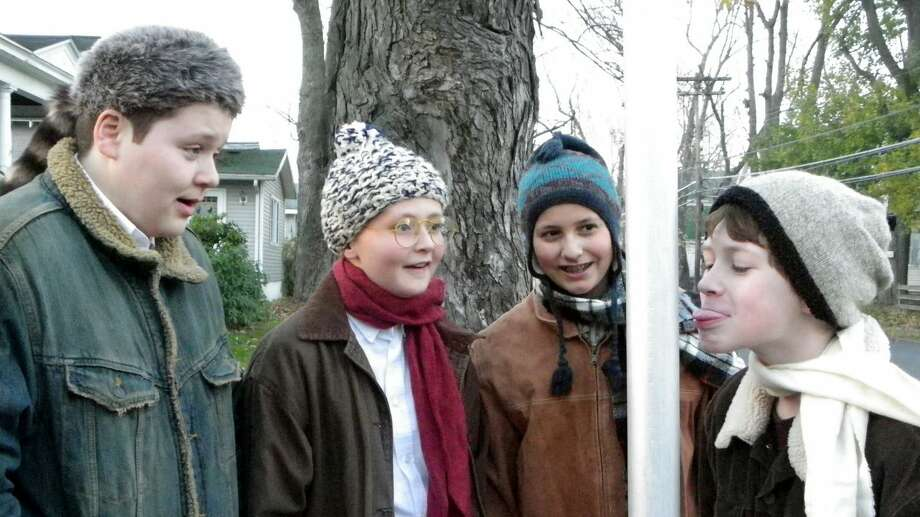 Scut Farkas (Jake Lehing), Ralphie Parker (Jack Siple), Schwartz (Luke Hayner) and Flick (Casey Roberts) have a dare going on in a scene from ''A Christmas Story,'' being staged this month by the Classic Theater Guild. (Sheila O'Shea) Photo: Picasa