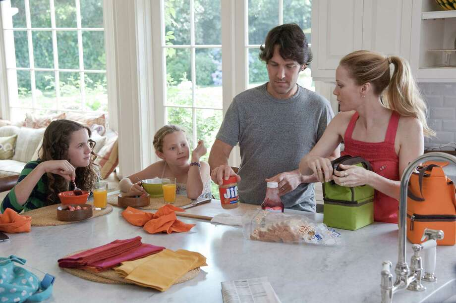"This publicity film image released by Universal Pictures shows, from left, Maude Apatow, Iris Apatow, Paul Rudd and Leslie Mann in a scene from the film, ""This is 40."" (AP Photo/Universal Pictures, Suzanne Hanover) Photo: Suzanne Hanover"