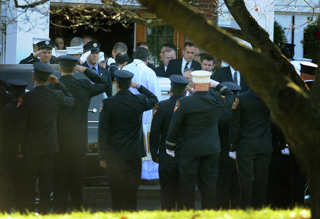 Firefighters salute as the casket of Daniel Barden, one of the twenty children killed in the Sandy Hook Elementary School shooting, leaves St. Rose of Lima Catholic Church in Newtown on Wednesday, December 19, 2012. Photo: Brian A. Pounds / Connecticut Post