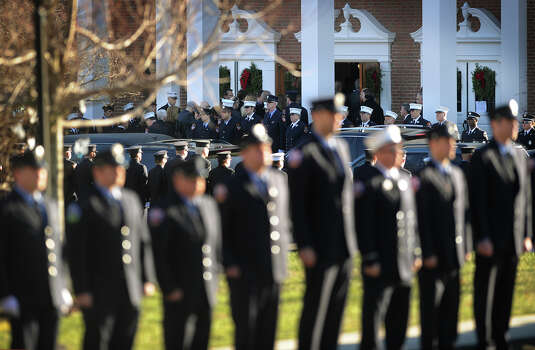 Firefighters stand at attention outside the funeral for Daniel Barden, one of the twenty children killed in the Sandy Hook Elementary School shooting, at St. Rose of Lima Catholic Church in Newtown on Wednesday, December 19, 2012. Photo: Brian A. Pounds / Connecticut Post
