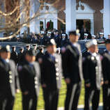 Firefighters stand at attention outside the funeral for Daniel Barden, one of the twenty children killed in the Sandy Hook Elementary School shooting, at St. Rose of Lima Catholic Church in Newtown on Wednesday, December 19, 2012.
