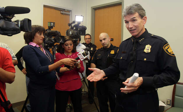 San Antonio Police Chief William McManus (right) speaks with members of the media Wednesday December 19, 2012 before meeting with San Antonio area school district and university police chiefs. McManus said he was meeting with the area chiefs to make sure all of their efforts would be coordinated should there ever be an emergency situation such as the one that recently took place in Connecticut. Photo: JOHN DAVENPORT, San Antonio Express-News / ©San Antonio Express-News/Photo Can Be Sold to the Public