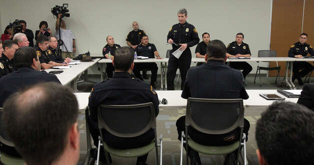 San Antonio Police Chief William McManus (center, standing) speaks Wednesday December 19, 2012 during a meeting with San Antonio area school district and university police chiefs and other law enforcment personnel. McManus said he was meeting with the area chiefs to make sure all of their efforts would be coordinated should there ever be an emergency situation such as the one that recently took place in Connecticut. Photo: JOHN DAVENPORT, San Antonio Express-News / ©San Antonio Express-News/Photo Can Be Sold to the Public