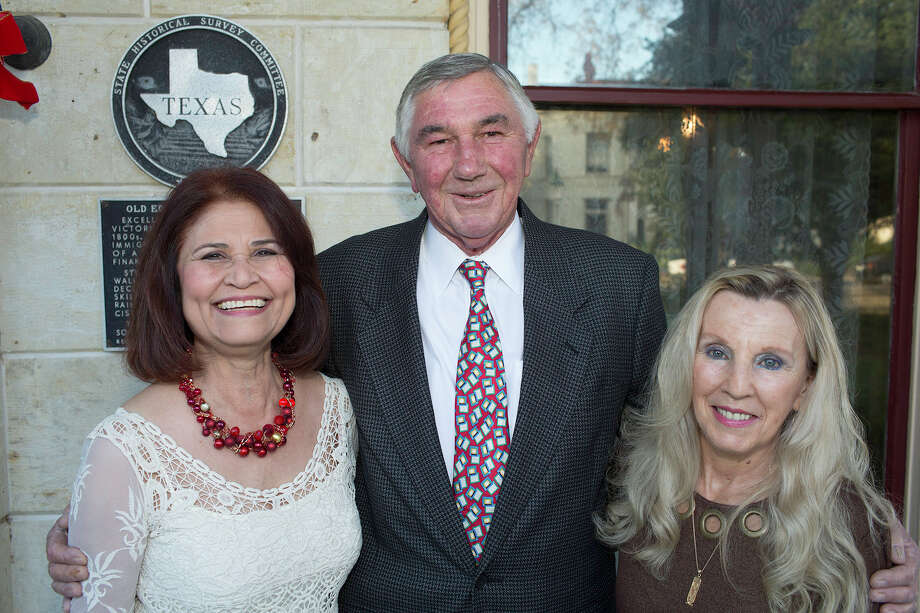 San Antonio Conservation Society's annual Weihnachtsfeier German  Christmas party: Board member Stella De La Garza (left), member Art  Dietel and society hospitality Chairwoman Christine Luttrell get  together during the party at the Steves Homestead.