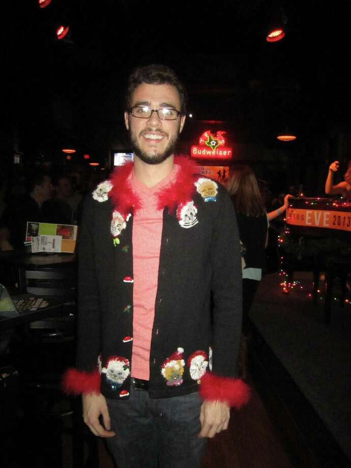 """Cheesy"" sweater contest winner James Jarrott models his ugly sweater. Photo: Jessica Elizarraras, San Antonio Express-News"
