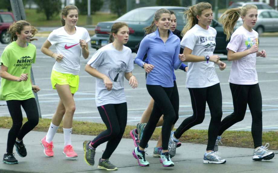 Green Wave veterans and young hopefuls run side by side as New Milford High School girls' track prepares for a busy 2012-13 campaign. December 2012 Photo: Norm Cummings