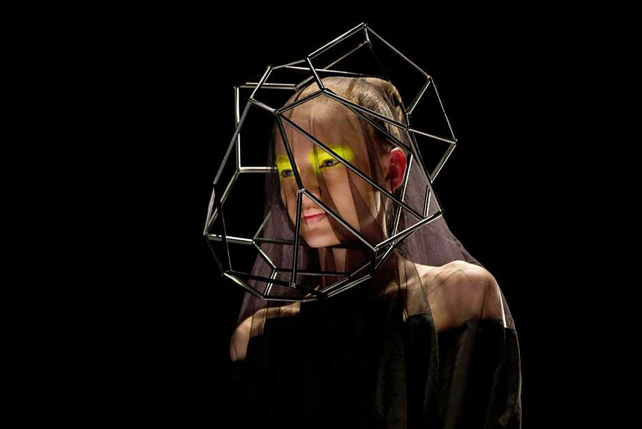 Caged beauty: A model wears a veil of wire bars in this Fishndag brand creation by Israeli designer Hagit Witman at Tel Aviv Fashion Week in Israel. Photo: Ariel Schalit, Associated Press