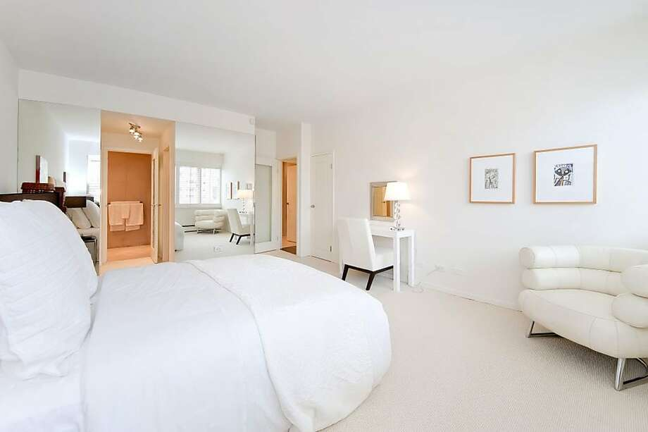 The master bedroom is seen here with the master bathroom in the background. Photo: Rebecca Daniels