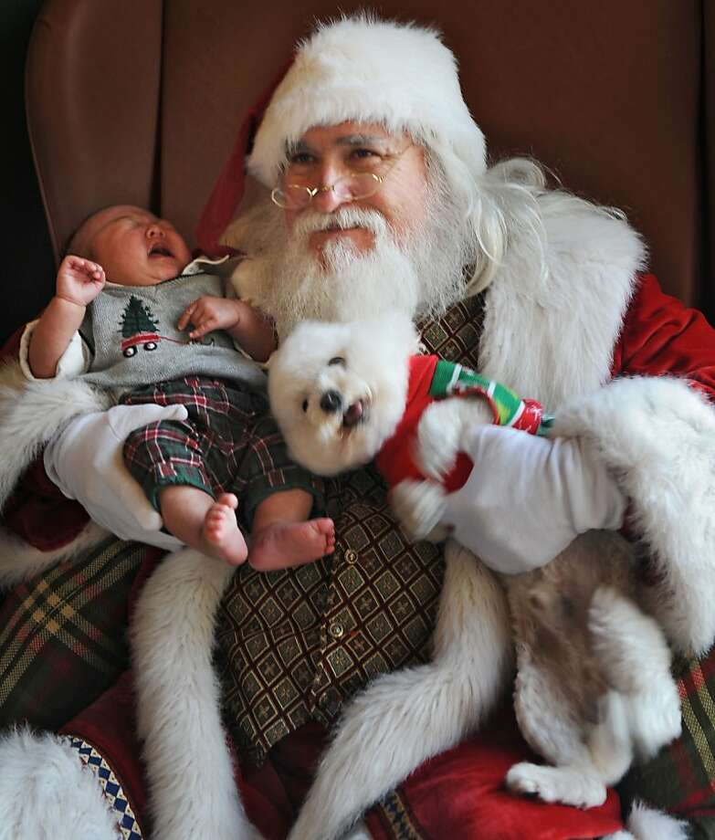 It's not easy being jolly:Screaming 9-month-old Lance Park and squirming Coco test Santa's patience during a photo session at St. Johns Town Center Mall in Jacksonville, Fla. Photo: Bob Mack, Associated Press