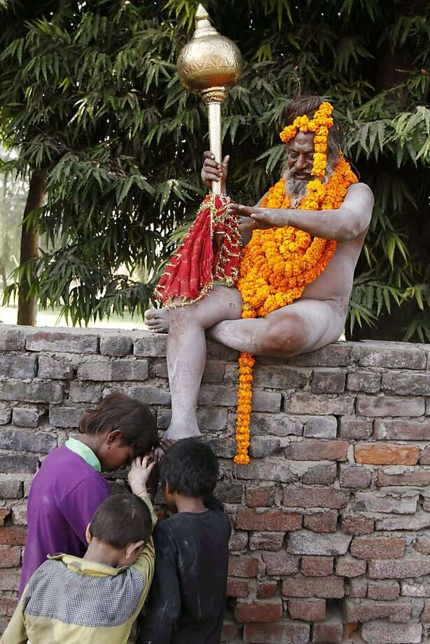 The naked man on the wall:In the San Francisco, he'd probably be arrested for public nudity, but in Allahabad, India, it's perfectly all right for a nagu sadhu (naked Hindu holy man) to bless children. Photo: Rajesh Kumar Singh, Associated Press