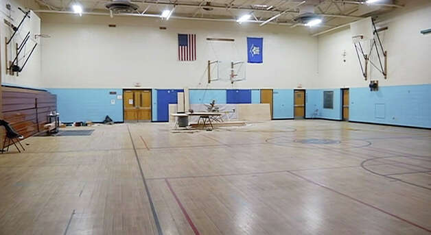 Workers setup Chalk Hill Middle School in Monroe, Conn. for use by Sandy Hook Elementary School students. Photo: Contributed Photo / The News-Times Contributed