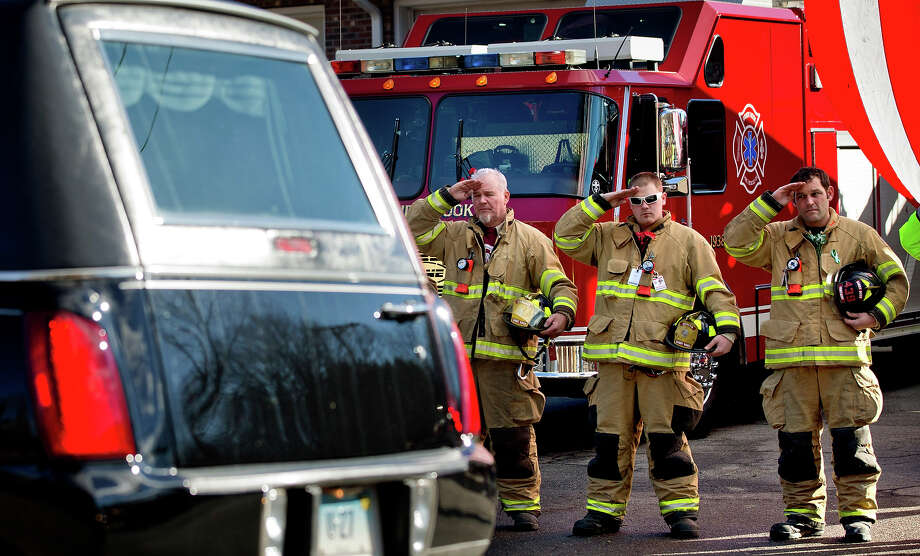 Firefighters salute as a hearse passes for the funeral procession to the burial of 7-year-old Sandy Hook Elementary School shooting victim Daniel Gerard Barden, Wednesday, Dec. 19, 2012, in Newtown, Conn. Barden was killed when Adam Lanza walked into Sandy Hook Elementary School in Newtown, Conn., Dec. 14, and opened fire, killing 26 people, including 20 children, before killing himself. Photo: AP