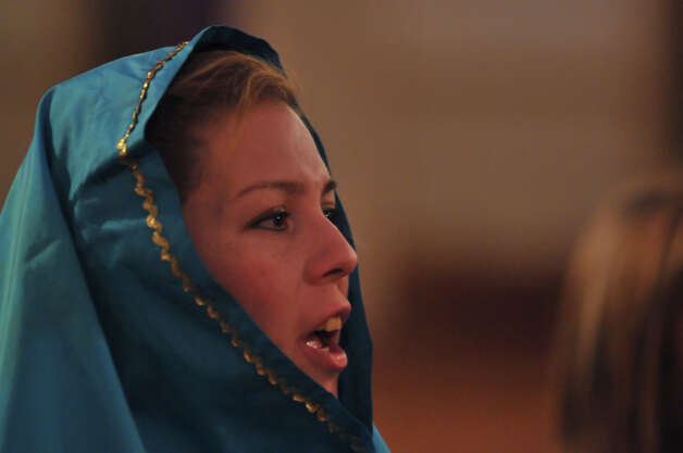 Marissa Benavidez, who portray's Mary in the Our Lady of Guadalupe chuch yearly Posada, sings prior to the start of the procession. Photo: Robin Jerstad/For The Express-Ne