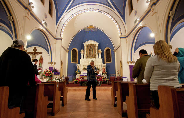 Father James Marshall plays his trumpet inside Our Lady of Guadalupe Church during a reheasal for their yearly Posada. Photo: Robin Jerstad/For The Express-Ne