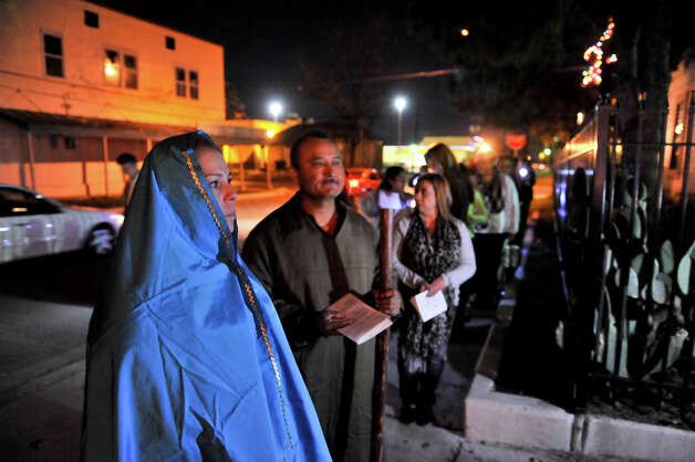 The Our Lady of Gudalupe Church Posada led by Marissa Benavidez as Mary and Jose Martinez as Joseph,  makes it's first stop on Fite St. near the intersection with El Paso. Photo: Robin Jerstad/For The Express-Ne
