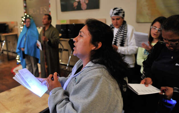 Maria Guadalupe sings Christmas songs as the Our Lady of Guadalupe yearly Posada ends at  Guadalupe St. Coffee House. Photo: Robin Jerstad/For The Express-Ne