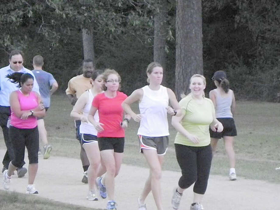Beginning runners learn how to run correctly at Powers in Motion clinics at Memorial Park.  Photo credit goes to Power in Motion. / DirectToArchive