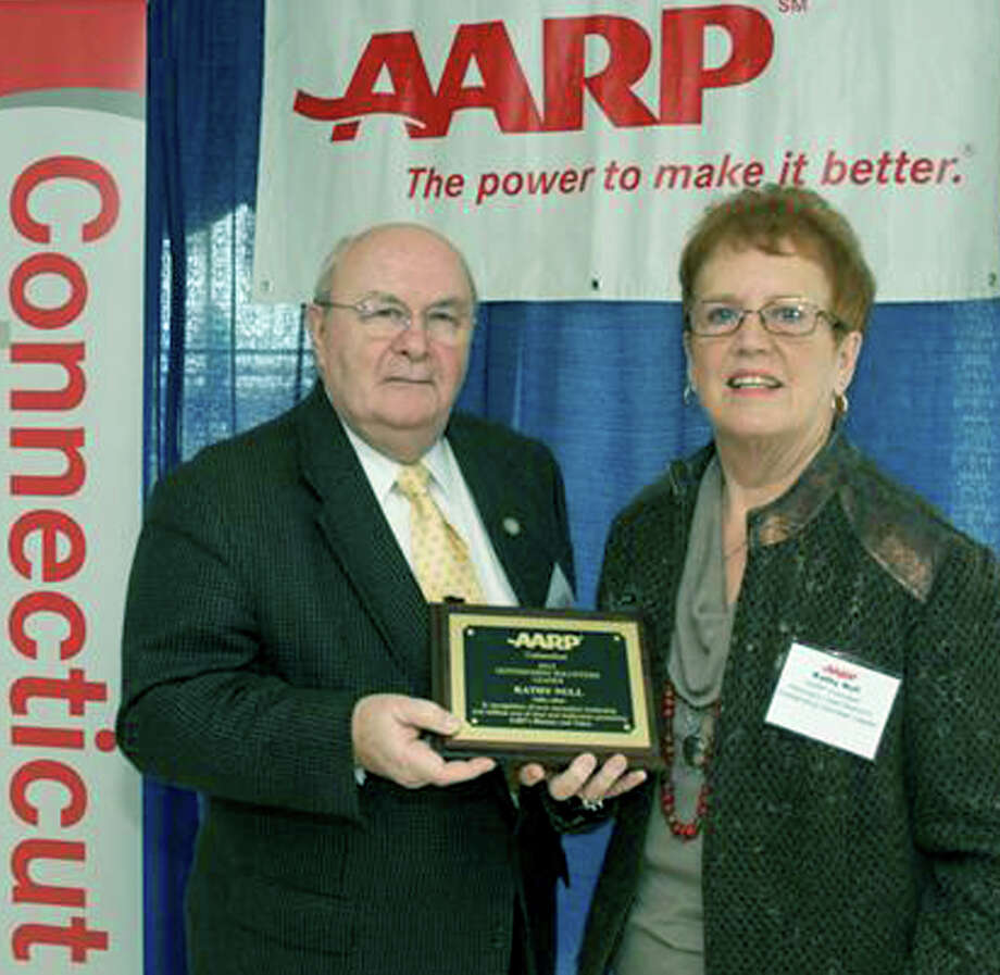 Kathy Null of Bridgewater is shown recently receiving the 2012 Volunteer Leader of the Year award from Joseph Quinn, the statewide driver safety coordinator for the state chapter of the American Association of Retired Persons (AARP).  Courtesy of the AARP Photo: Contributed Photo