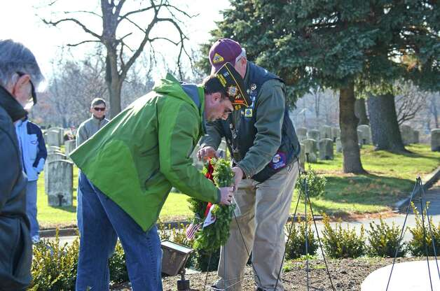 Veteran Brian O'Malley, who served in Iraq and Afghanistan, lays a remembrance wreath in memory of those who served and are serving in the Unites States Army during the Wreaths Across America ceremony at the Veterans Cemetery in Darien on Saturday, Dec. 15, 2012. Photo: Jeanna Petersen Shepard