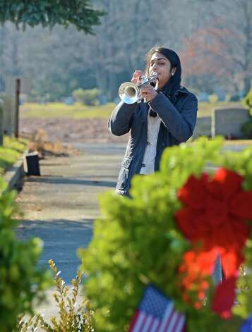 Darien High School student Sandhya Avula plays TAPS during the Wreaths Across America ceremony at the Veterans Cemetery in Darien, Conn. on Dec. 15, 2012. Photo: Jeanna Petersen Shepard