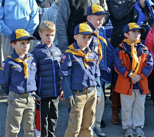 Darien cubscouts show their respect during the Wreaths Across America ceremony at the Veterans Cemetery in Darien on Saturday, Dec. 15, 2012.  From left to right: Charlie Salmore, Jackson Davenport, Eric Taylor, Trey Davenport, and David Straubel. Photo: Jeanna Petersen Shepard
