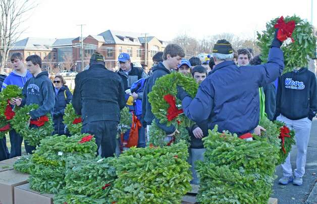 VFW volunteers handed out hundreds and hundreds of wreaths, 761 to be exact, to be distributed across Veterans Cemetery last Saturday, Dec. 15, 2012 in Darien, Conn. Photo: Jeanna Petersen Shepard