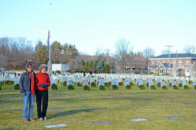 After all the wreaths were placed at Veterans Cemetery during the Wreaths Across America ceremony, Cappy Craig Waters and Patricia Parlette reflect.  Dec. 15, 2012, Darien, Conn. Photo: Jeanna Petersen Shepard