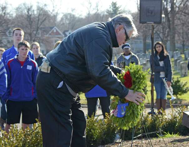 Air Force Veteran Rollie Holub lays a remembrance wreath in memory of those who served and are serving in the Unites States Air Force, during the Wreaths Across America ceremony at the Veterans Cemetery in Darien, on Saturday, Dec. 15, 2012. Photo: Jeanna Petersen Shepard