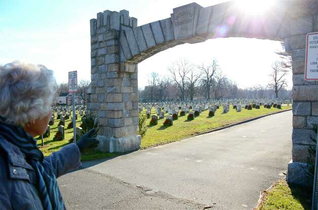 Ann Penrose stands outside the Veterans Cemetery gates and remarks on all the wreaths that had been placed on the gravestones during the Wreaths Across America event last Saturday, Dec. 15, in Darien, Conn. Photo: Jeanna Petersen Shepard