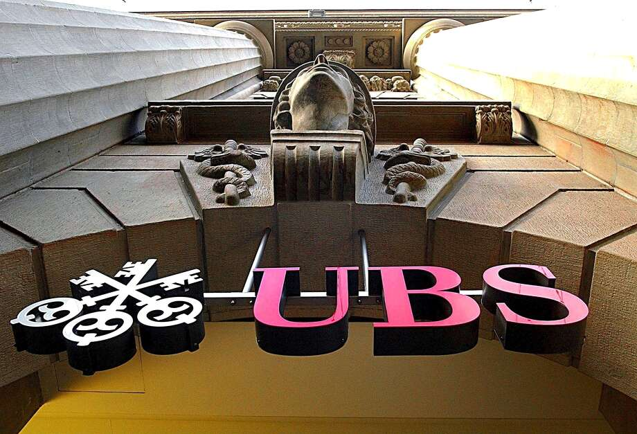 The logo of Swiss bank UBS is prominent in Zurich, Switzerland. A settlement with U.S., British and Swiss regulators in a rate-rigging scandal caps a tough year for the company. Photo: STEFFEN SCHMIDT, SUB / KEYSTONE