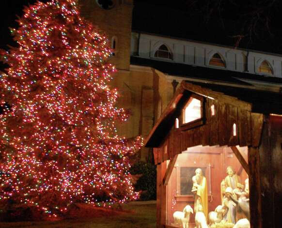 A manger depicting the Christmas Nativity is set outside Assumption Church on Riverside Avenue. Photo: Jarret Liotta / Westport News contributed