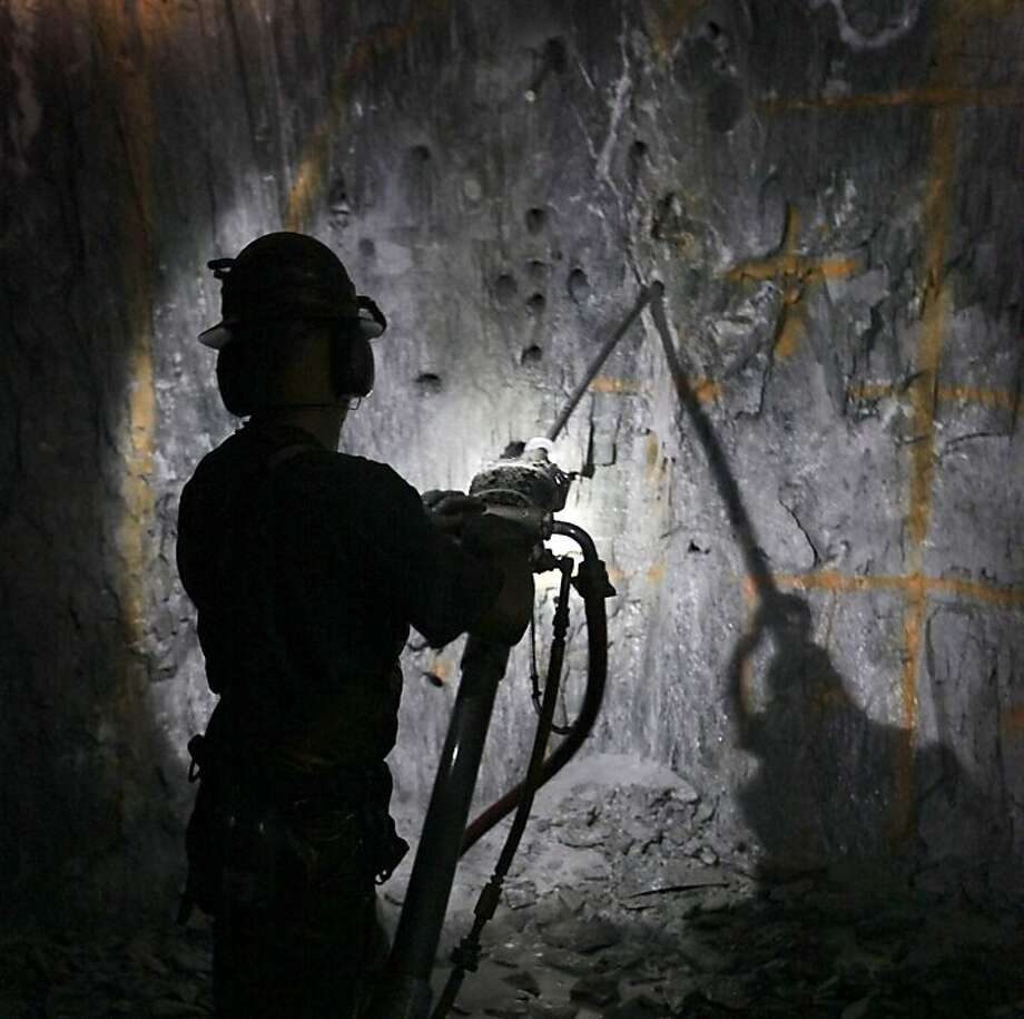 Keith Emerald drills holes to be packed with explosives at the Sutter Gold Mining Co.'s mines. Photo: Rich Pedroncelli, Associated Press