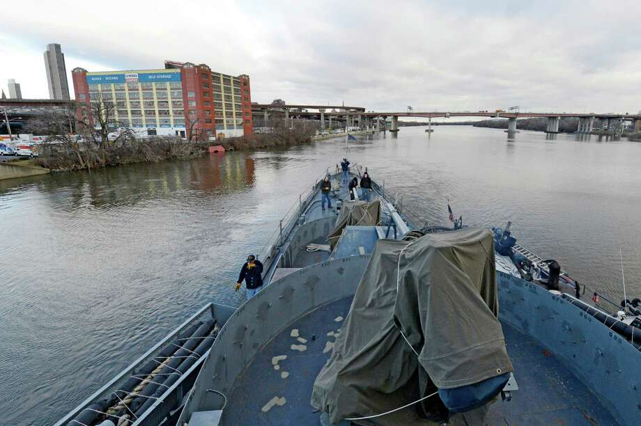 The USS Slater is moved from the Albany, N.Y., side of the Hudson River to the Rensselaer side for its winter berth during its semi-annual sail across the river on Dec 19, 2012.     (Skip Dickstein/Times Union) Photo: Skip Dickstein / 00020379A