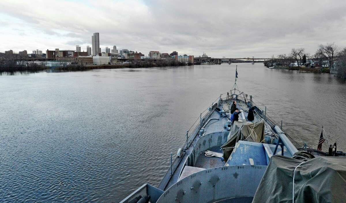 The USS Slater is moved from the Albany, N.Y., side of the Hudson River to the Rensselaer side for its winter berth during its semi annual sail across the channel Dec 19, 2012. (Skip Dickstein/Times Union)