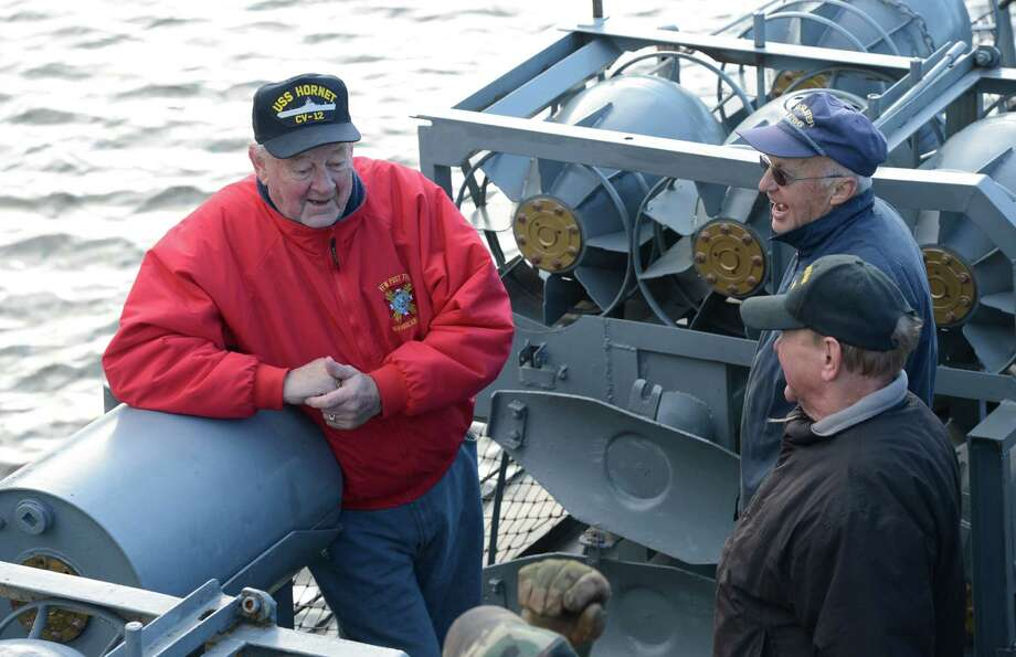 "Bill Von Blomberg, 86, tells ""war stories"" to volunteers as the USS Slater is moved from the Albany, N.Y. side of the Hudson River to the Rensselaer side.   Von Blomberg served on the USS Hornet during World War II.  (Skip Dickstein/Times Union) Photo: Skip Dickstein / 00020379A"